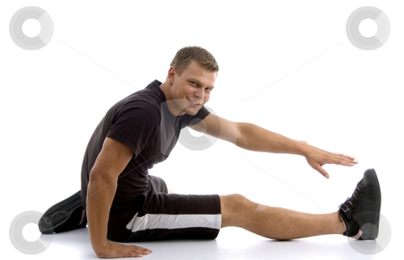 Male stretching his leg stock photo, Male stretching his leg on an isolated background by Imagery Majestic