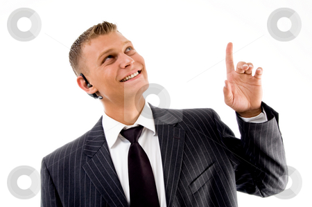 Man showing happiness and pointing upwards stock photo, Man showing happiness and pointing upwards on an isolated background by Imagery Majestic