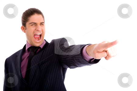 Portrait of businessman pointing stock photo, Portrait of businessman pointing against white background by Imagery Majestic