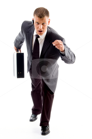 Handsome young executive posing to camera  stock photo, Handsome young executive posing to camera with white background by Imagery Majestic