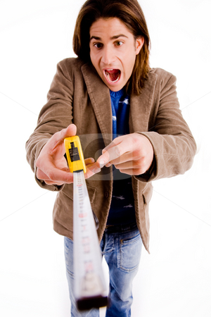 Front view of man showing measuring tape stock photo, Front view of man showing measuring tape on an isolated white background by Imagery Majestic