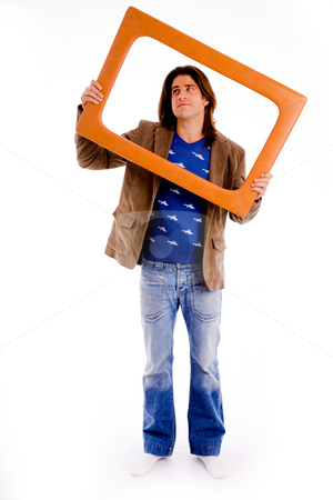 Front view of male holding frame and looking up stock photo, Front view of male holding frame and looking up against white background by Imagery Majestic