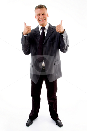 Standing professional with thumbs up stock photo, Standing professional with thumbs up on an isolated white background by Imagery Majestic