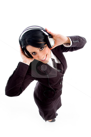 Young lawyer holding headphone stock photo, Young lawyer holding headphone on an isolated white background by Imagery Majestic