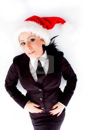Young employee wearing christmas hat stock photo, Young employee wearing christmas hat on an isolated white background by Imagery Majestic