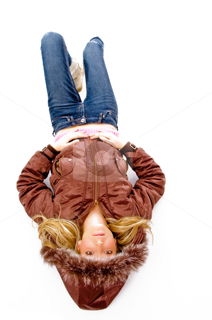 Top view of resting beautiful model looking at camera stock photo, Top view of resting beautiful model looking at camera with white background by Imagery Majestic
