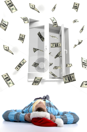 Man with christmas hat watching flying dollars stock photo, Laying man christmas hat watching three dimensional flying dollars out of a window by Imagery Majestic