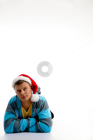 Laying man with christmas hat  stock photo, Laying man with christmas hat on an isolated white background by Imagery Majestic