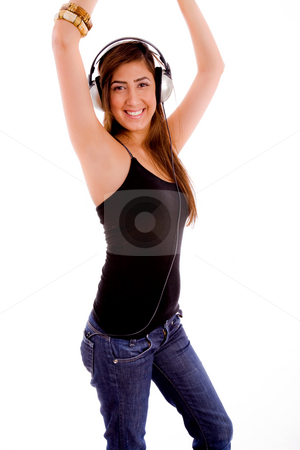 Woman enjoying music dancing stock photo, Side view of young woman enjoying music with white background by Imagery Majestic