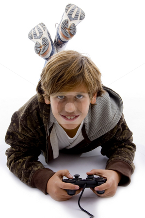 Front view of smiling young boy with joystick stock photo, Front view of smiling young boy with joystick against white background by Imagery Majestic
