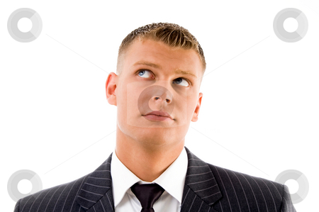 Portrait of executive looking upward stock photo, Portrait of executive looking upward with white background by Imagery Majestic