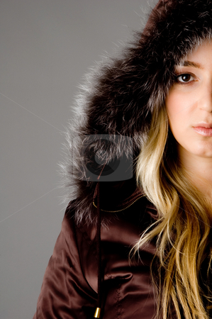 Half length of beautiful woman looking at camera stock photo, Half length of beautiful woman looking at camera against white background by Imagery Majestic