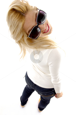 High angle view of smiling young female stock photo, High angle view of smiling young female on an isolated background by Imagery Majestic