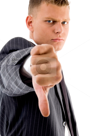 Thumbs down Businessman stock photo, Side pose of businessman with thumbs down with white background by Imagery Majestic