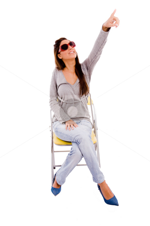 Front view of young female pointing up stock photo, Front view of young female pointing up against white background by Imagery Majestic