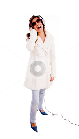 Side pose of standing model enjoying music stock photo, Side pose of standing model enjoying music with white background by Imagery Majestic
