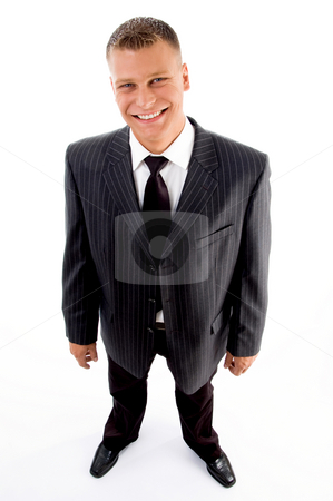 Standing pleased businessman stock photo, Standing pleased businessman against white background by Imagery Majestic