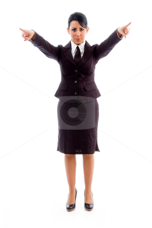 Young businesswoman pointing with both hands stock photo, Young businesswoman pointing with both hands against white background by Imagery Majestic