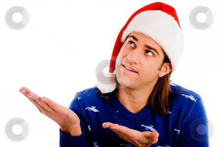 Portrait of man wearing christmas hat and presenting stock photo, Portrait of man wearing christmas hat and presenting with white background by Imagery Majestic