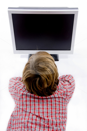 Watching tv stock photo, Top view of boy watching tv on an isolated background by Imagery Majestic