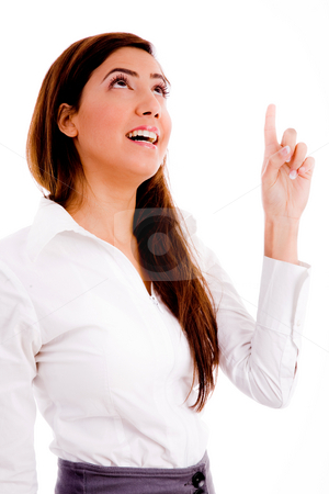 Portrait of businesswoman pointing up stock photo, Portrait of businesswoman pointing up on an isolated white background by Imagery Majestic