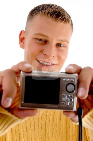 Man looking into camera stock photo, Man looking into camera on an isolated background by Imagery Majestic