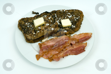 Toast and Bacon stock photo, A plate of morning breakfast including two slices of French Toast and some strips of bacon by Richard Nelson