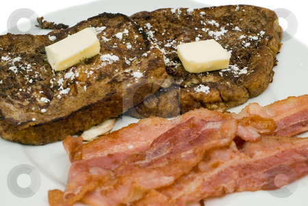 French Toast and Bacon stock photo, Closeup of some French Toast and bacon, shot on a white plate by Richard Nelson