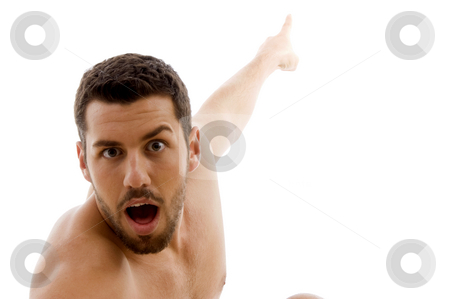 Front view of surprised man pointing  stock photo, Front view of surprised man pointing with white background by Imagery Majestic