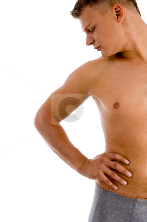 Man looking at his muscular arm stock photo, Man looking at his muscular arm against white background by Imagery Majestic