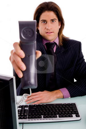 Get the phone call stock photo, Front view of professional offering call against white background by Imagery Majestic