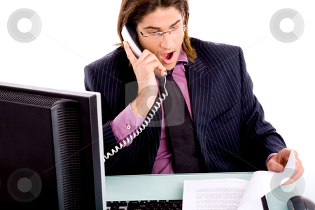 Shocked professional talking on phone stock photo, Front view of shocked professional talking on phone on an isolated white background by Imagery Majestic