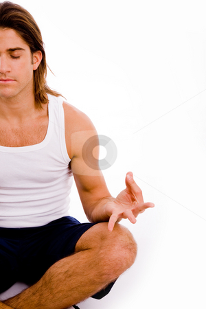 Half length view of man doing yoga stock photo, Half length view of man doing yoga on an isolated white background by Imagery Majestic