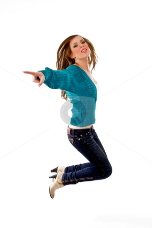 Side view of young female jumping stock photo, Side view of young female jumping with white background by Imagery Majestic