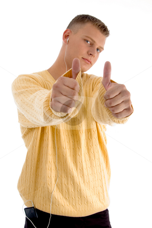 Handsome guy showing  thumbs up with both hands stock photo, Handsome guy showing  thumbs up with both hands on an isolated background by Imagery Majestic