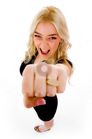 Top view of smiling female showing fist stock photo, Top view of smiling female showing fist with white background by Imagery Majestic