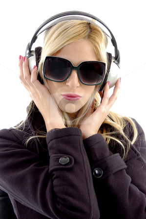 Front view of woman listening music stock photo, Front view of woman listening music against white background by Imagery Majestic