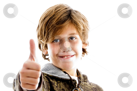 Front view of pleased kid with thumbs up   stock photo, Front view of pleased kid with thumbs up with white background by Imagery Majestic