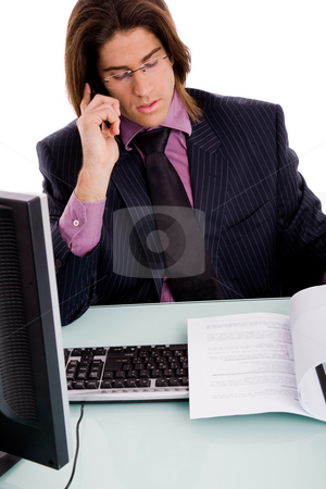 Front view of businessman busy on phone stock photo, Front view ofbusinessman busy on phone against white background by Imagery Majestic