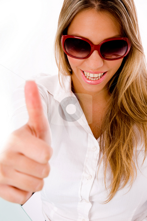 Front view of smiling female with thumbs up stock photo, Front view of smiling female with thumbs up with white background by Imagery Majestic