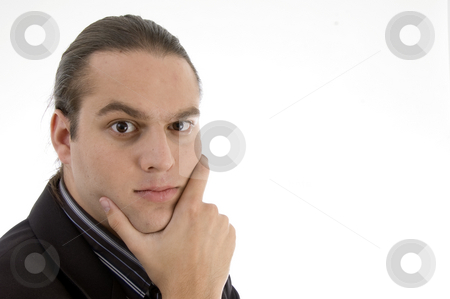 Portrait of angry businessman stock photo, Portrait of angry businessman on an isolated white background by Imagery Majestic