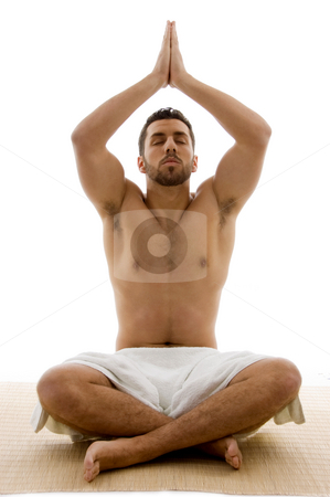 Front view of male performing yoga  stock photo, Front view of male performing yoga on an isolated background by Imagery Majestic