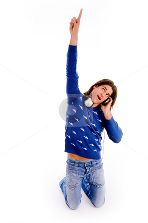 Musical themed image of man stock photo, Front view of pointing male listening music with white background by Imagery Majestic