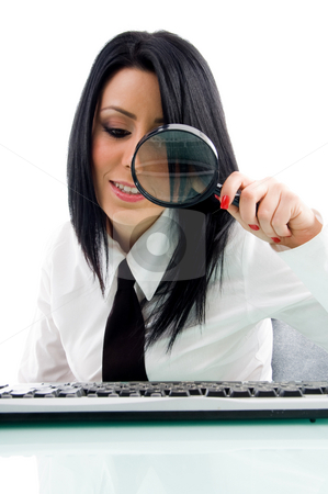 Woman looking through lens stock photo, Woman looking through lens with white background by Imagery Majestic