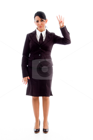 Young lawyer showing counting hand gesture stock photo, Young lawyer showing counting hand gesture on an isolated white background by Imagery Majestic