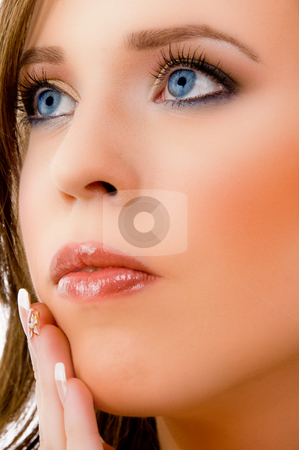 Close view of female face stock photo, Close view of female face against white background by Imagery Majestic