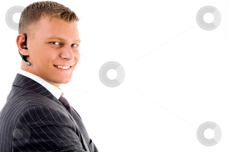 Smiling man listening with bluetooth stock photo, Smiling man listening with bluetooth on an isolated white background by Imagery Majestic
