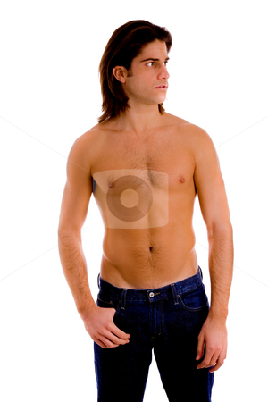 Front view of young man looking aside stock photo, Front view of young man looking aside against white background by Imagery Majestic