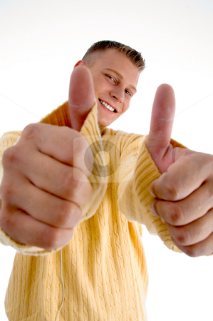 Smiling man showing  thumbs up with both hands stock photo, Smiling man showing  thumbs up with both hands on an isolated background by Imagery Majestic