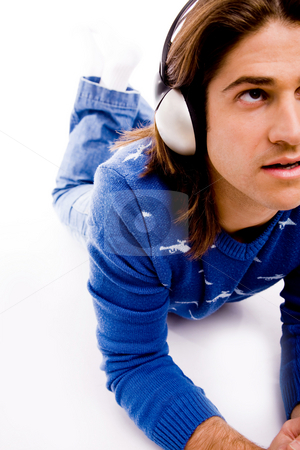 Man listening music stock photo, Halflength view of man listening music on an isolated white background by Imagery Majestic
